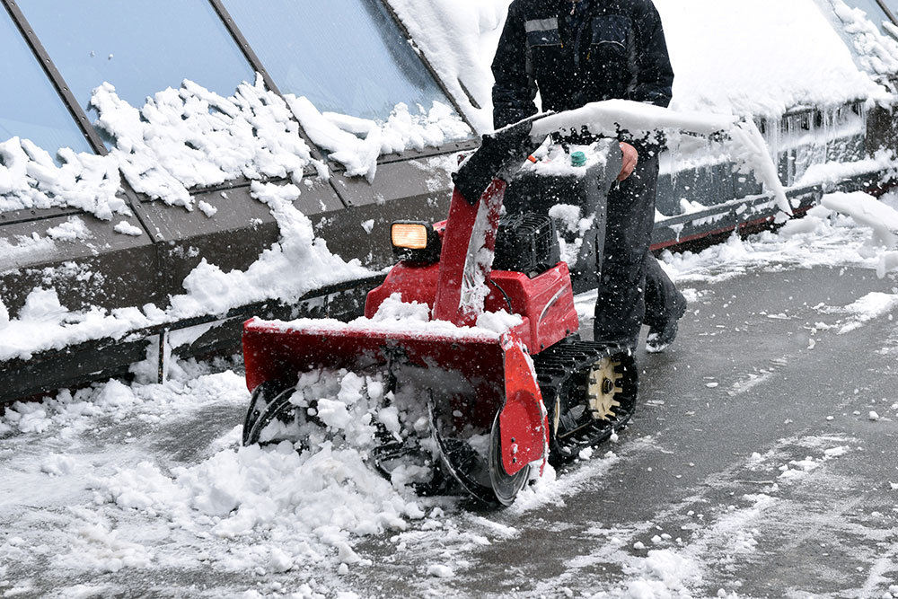 Man Removing Snow with a Snow Blower